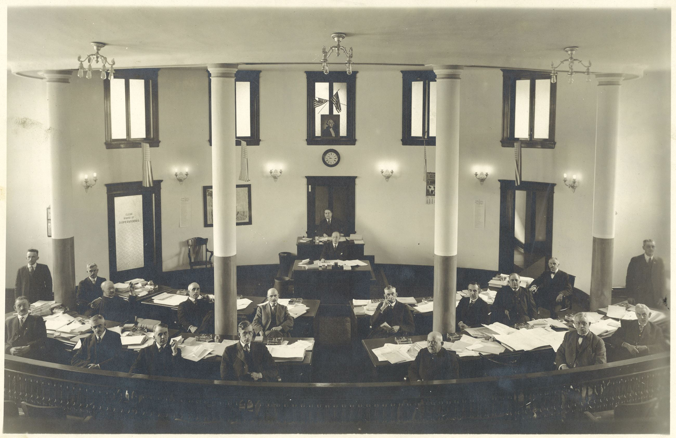 This is a circa 1920 image of the Board of Supervisors taken in the Courthouse Chambers during a mee