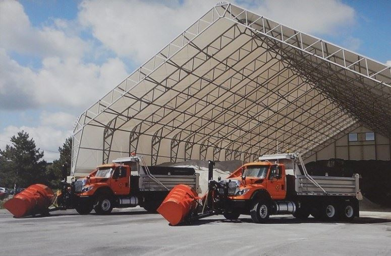 Snowplows in front of salt storage