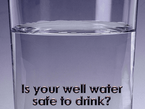 Glass filled with drinking water from an individual well and message asking if the water is safe to