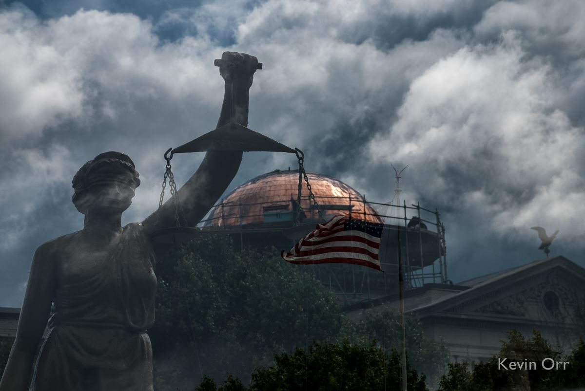 Image of statue of Maat (Justice), courthouse dome, and US flag