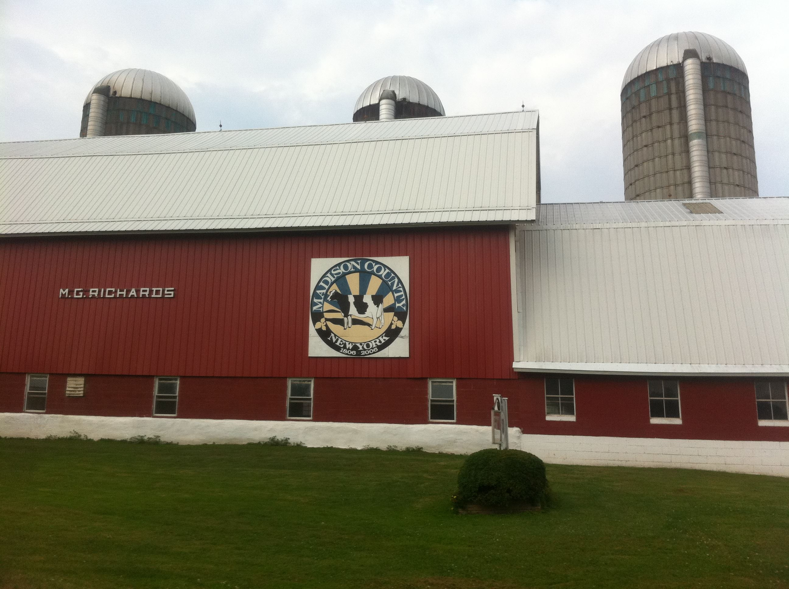 Large red barn with bicentennial seal on the side